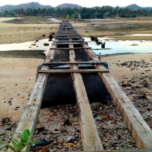 A rickety bridge amidst the arid terrain near the Novotel.