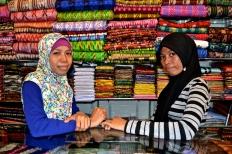 Two ladies at a souvenir shop on Jalan Somba Opu