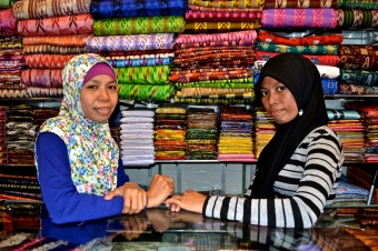 Two ladies at a souvenir shop on Jalan Somba Opu