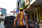 A man walking on Jalan Somba Opu.