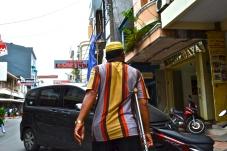 A man walking on Jalan Somba Opu.