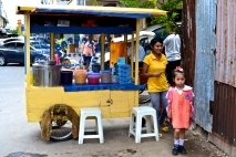 A food cart and family