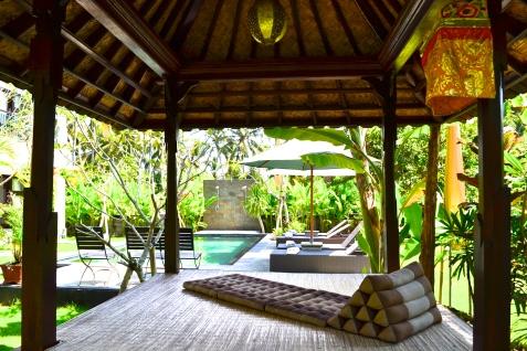 The lounge area near the pool at Puri Asri.