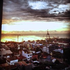 A view at sunset of the city near the Pantai Losari