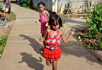Village children playing hopscotch