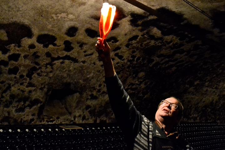 Bottle to the light: the wonder shows us the sediment that collects in the rosé making process.