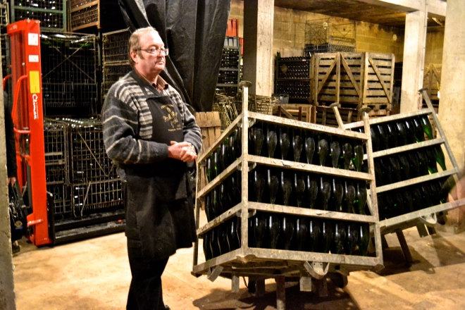 Michael Caine showing us the riddling cages that (unlike the wooden racks) cut down on the manual turning and tilting time. Still pretty old school.